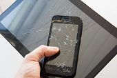 Broken Glass Screen Smartphone In Hand Of Upset Man. The Guy Is Holding A Black Smartphone With A Br poster