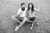 Man Bearded Hipster And Pretty Woman Cheerful Faces. Youth Day. Couple In Love Cheerful Youth Booth  poster