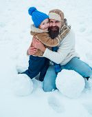 Cute Son Hugs His Dad On Winter Holiday. Daddy And Boy Smiling And Hugging. Happy Smiling Family On  poster