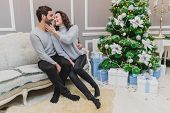 Danish Hygge And Homely Environment Concept. Up-view Photo Of Lovely Couple Enjoying Christmas Time  poster
