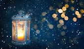 Beautiful Winter Christmas Background With Copy Space. Lighted Christmas Lantern On Dark Background  poster