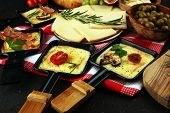Delicious Traditional Swiss Melted Raclette Cheese On Diced Boiled Or Baked Potato. poster