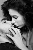 stock photo of beautiful young woman  - a beautiful young girl is kissing a guy - JPG