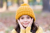 Autumn Skin Care. Little Child Wear Hat On Autumn Landscape. Small Girl Touch Clean Pure Skin. Organ poster