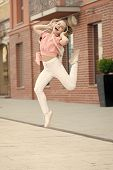 Dancing Cutie. Adorable Dancer Moving To Music On City Street. Small Child Enjoy Dancing To Modern M poster