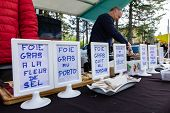 Signs Showing Various Foie Gras Dishes Are Seen On The Counter Of A Hot Food Stand During A Local Fa poster