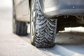 Close-up Of Car Wheels Rubber Tire In Deep Snow. Transportation And Safety Concept. poster