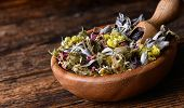 Healing Herbs From Various Medicinal Herbs And Flowers In Wooden Bowl With Scoope On The Rustic Tabl poster