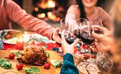 Family Toasting Red Wine And Having Fun At Christmas Supper Party - Holiday Celebration Concept With poster