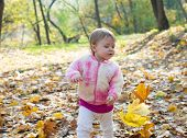 Happy Little Child, Baby Girl Laughing And Playing In The Autumn On The Nature Walk Outdoors. Little poster