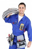 stock photo of electrician  - Handsome electrician - JPG