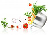 stock photo of food preparation tools equipment  - Fresh vegetables coming out from a stainless steel casserole pot - JPG