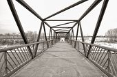 stock photo of trestle bridge  - Sepia trestle pedestrian bridge in the winter - JPG