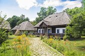 stock photo of household farm  - Old Traditional Romanian Rural Household On A Beautiful Summer Day - JPG