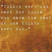 Inspirational quote by John Wooden on earthy brown background