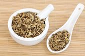 Licorice herb root used in chinese herbal medicine in a mortar with pestle and spoon. Gan cao. Glycy