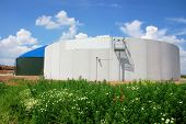 stock photo of biogas  - Biomass energy plant construction site with silo - JPG