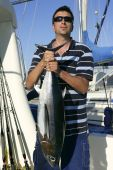 Big Game Fisherman With Saltwater Tuna