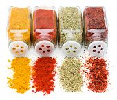 picture of household  - Different spices spilling from spice jars isolated on white background - JPG