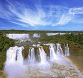 The best-known falls in the world - Iguazu. The magnificent rainbow costs over roaring water streams. poster