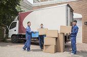 image of moving van  - Movers unloading moving van - JPG
