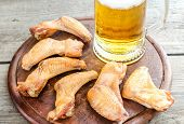 Smoked Chicken Wings With Spicy Sauce And Glass Of Beer