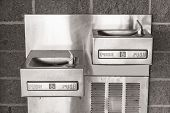 picture of handicapped  - Wall mounted pair of shining metal drinking fountains - JPG