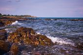 stock photo of mendocino  - Waves along the rocky shore beautiful lining - JPG