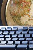 image of midterm  - Computer keyboard and earth globe - JPG