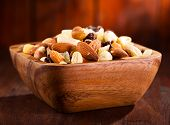 picture of mixed nut  - bowl of mix nuts and dried fruits on wooden table - JPG