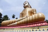 stock photo of vihara  - Big Buddha in Wewurukannala Vihara near Dikwella Sri Lanka - JPG