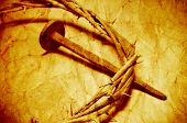 a nail and the Jesus Christ crown of thorns, with a retro filter effect