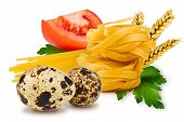stock photo of egg noodles  - egg noodles pasta tomato slice tomatoes ears of wheat fresh parsley leaf and quail egg on a white background - JPG