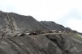 stock photo of bromo  - People and horses on the volcano Bromo in Indonesia - JPG