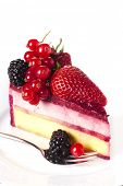 Piece cake with fresh berry on white isolated background