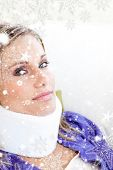 picture of neck brace  - Young woman with a neck brace looking in the camera against snow falling - JPG