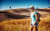 picture of fall-wheat  - Tourist girl enjoying view of beautiful dry golden wheat hills - JPG