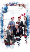 stock photo of christmas theme  - Business people with novelty Christmas hat toasting at a party against christmas themed frame - JPG