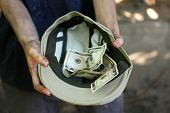 foto of beggar  - Homeless beggar money on his hat - JPG