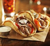 stock photo of greeks  - greek gyros with tzatziki sauce and fries - JPG