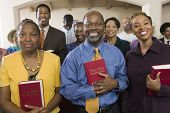 image of pews  - Sunday Service Congregation standing in church with Bibles portrait - JPG