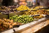 stock photo of grocery store  - Olives on sale - JPG