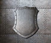picture of ironclad  - metal shield over armor plates background - JPG
