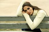 image of lonely woman  - Young lonely woman on bench in park - JPG