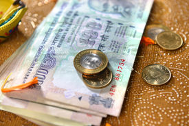 stock photo of laxmi  - Assorted indian currency and coins - JPG