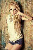 stock photo of denim jeans  - Modern girl with blonde dreadlocks - JPG