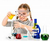 stock photo of chemistry  - happy little girl with flasks for chemistry isolated on a white background - JPG