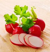 stock photo of radish  - Fresh radishes isolated on wooden background - JPG