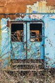 stock photo of train-wheel  - Rusty train wagons in a train station near Bucharest waiting insurance evaluation - JPG