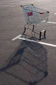 picture of trolley  - Shopping supermarket trolley on the sunny parking - JPG